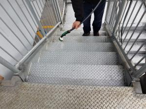 Front St. Parkade Staircase during cleaning